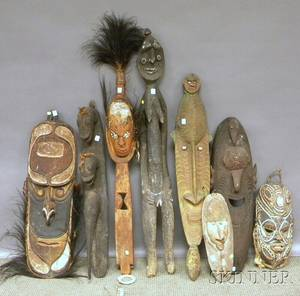 Eight Papua New Guinea Carved Wood Masks and Sculptures