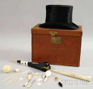 Mans Top Hat in Leather Case a Carved Ivoryhandled Parasol and a Group of Mostly Ivory and Bone Sewing Implements