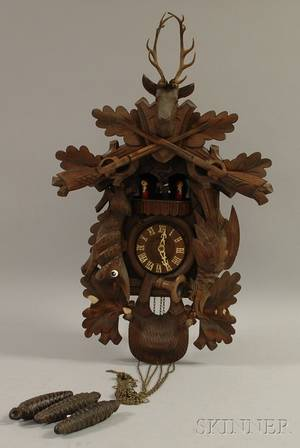 Walnut Black Forest Cuckoo Clock a Le Coultre Brass Atmos Clock and a German Clock with Glass Dome