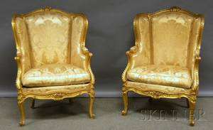 Pair of Louis XVstyle Gold Damask Upholstered Carved Giltwood Bergeres