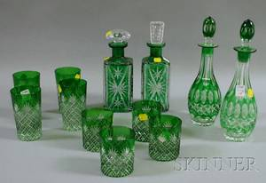 Two Pairs of Green CuttoClear Glass Decanters and a Set of Eight Glasses