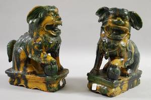 Two Large Glazed Pottery Foo Dogs