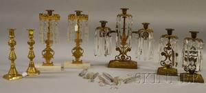 Giltmetal Girandole Candelabra Two Pairs of Giltmetal Girandole Candlesticks and a Pair of Brass Candlesticks