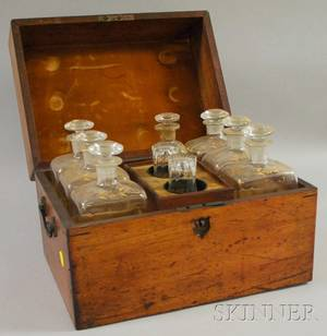 Walnut Spirit Chest with a Partial Set of Seven Giltdecorated Colorless Blown Glass Decanters and a Pair of Glasses