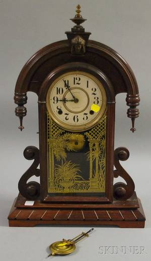 E Ingraham Carved Walnut Shelf Clock