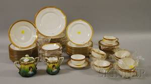 Sixtyseven Haviland Limoges Giltedge Porcelain Partial Dinner Set with a Viennastyle Painted Porcelain Creamer and Covered Sugar