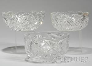 Two Colorless Cut Glass Bowls and a Footed Bowl