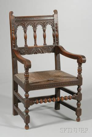 Hale  Kilburn Attributed Jacobeanstyle Inlaid Carved Oak Armchair with Rush Seat