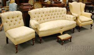 Late Victorian Upholstered Settee a Slipper Chair a Queen Anne Style Wing Chair and an Empire Footstool