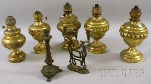 Five Brass Kerosene Table Lamps a Bronze Candlestick and an Israeli Brass Candelabra