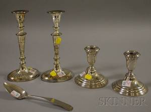 Pair of Sterling Silver Candleholders a Coin Silver Spoon and a Pair of Silver Plated Columnar Candlesticks