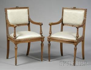 Pair of Louis XVI Style Carved Walnut Open Armchairs