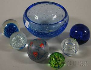 Six Contemporary Blown Glass Paperweights and a Blue Glass Bowl