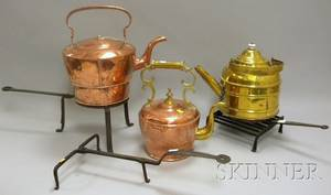 Three Copper and Brass Hot Water Kettles a Wrought Iron Trivet Gridiron and Rotary Gridiron Base