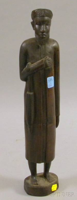 African Carved Wood Sculpture of a Man with a Long Coat