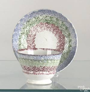 Red green and blue circular rainbow spatter cup and saucer