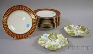Set of Twelve Limoges Porcelain Dinner Plates and Two Gilt and Foliatepainted Serving Dishes