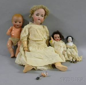 Three German Bisque Head Dolls a China Head Doll and Four Pieces of Wooden Doll Furniture