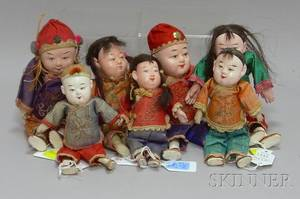 Seven Small Chinese Dolls