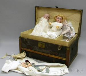 Two German Bisque Head Dolls and a Dolls Trunk with Clothing