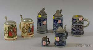 Five German Cobalt Highlighted Molded Stoneware Steins and a Pair of German PUG Stoneware Steins