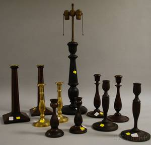 Four Pairs of Wooden Candlesticks a Pair of Brass Candlesticks and a Turned Wood Table Lamp
