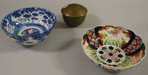 Two Asian Porcelain Bowls and an Engraved and Punch Decorated Brass Tea Caddy