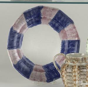 Blue and red rainbow paneled plate
