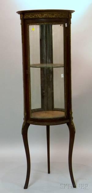 Louis XVIstyle Giltmetal mounted Mahoganyfinished Cylindrical Vitrine Cabinet