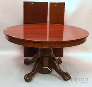 Circular Carved Mahogany Pedestalbase Dining Table with BallandClaw Feet