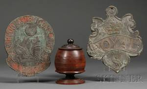 Two Pressed Sheet Copper Fire Marks and a Lignum Vitae Turned Covered Jar