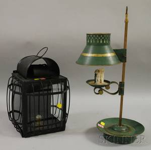 Painted Decorated Tin and Brass Adjustable Candle Lamp and a Blackpainted Metal and Glass Carriage Candle Lantern