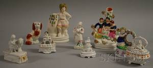 Eight Assorted Staffordshire Figural Items and a Parian Figural Spill Vase