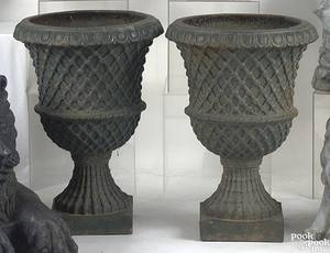 Pair of green painted cast iron urns mid 19th c