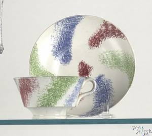 Unusual red green and blue rainbow swirl miniature handled cup and saucer