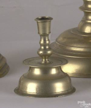 Two similar Nuremburg bell base minaiture candlesticks late 17th c