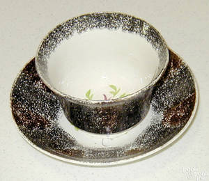 Black and brown rainbow spatter cup and saucer 19th c