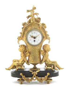 A French Gilt and Patinated Bronze Figural Mantel Clock