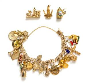 A 14 Karat Yellow Gold Charm Bracelet with 23 Attached Charms
