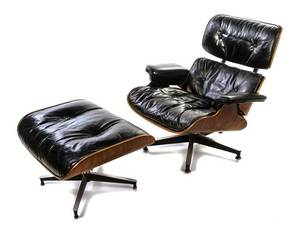 A Charles and Ray Eames Rosewood Lounge Chair and Ottoman