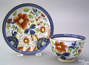 Gaudy Dutch handless cup and saucer 19th c