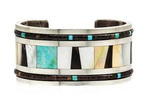 A Silver MotherofPearl Tortoise Shell and Turquoise Cuff Bracelet