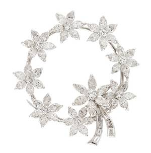 A 14 Karat White Gold and Diamond Circle Brooch