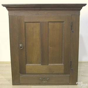 Pennsylvania walnut hanging cupboard early 19th c