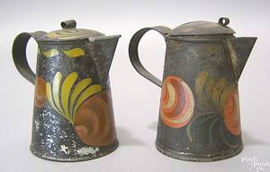Two black toleware syrup pitchers 19th c