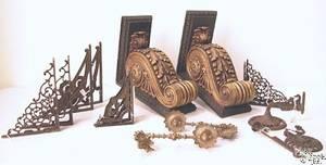 Five pair of cast iron shelf brackets