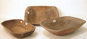 Three carved wooden trenchers