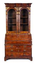 A George II Parcel Gilt Walnut Secretary Bookcase