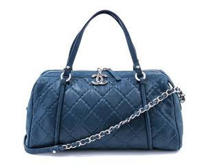 A Chanel Iridescent Blue Quilted Relax Bowling Handbag