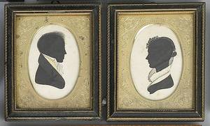 Pair of American fabric and ink on paper oval silhouette early 19th c